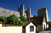 Gotland - Visby: along Murgatan, houses, wall and tower - photo by A.Ferrari
