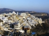 Greek islands - Santorini / Thira / JTR: Fira - terraces - top of the hill: Orthodox Cathedral - background: mount Profitis Ilias - photo by A.Dnieprowsky