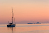 Greece - Paros: Sunset view of a sailboat in Paroikia harbour - photo by D.Smith