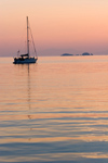 Greece - Paros: Sunset view of a sailboat in Paroikia harbour II - photo by D.Smith