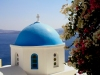 Greek islands - Santorini / Thira: flowers and blue dome - church dome - cupola - photo by A.Dnieprowsky