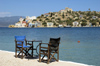 Greece, Kastellorizo: chairswith a view. Sit out on the edge of Kastellorizo harbour or jump in thewater for a swim - photo by P.Hellander