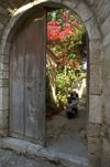 Greece, Dodecanese Islands,Rhodes: scooter in doorway of old house in Old Town - photo by P.Hellander
