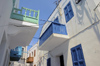 Greece, Dodecanese Islands,Nisyros: painted wooden balconies overlooking the streets of Mandraki - photo by P.Hellander
