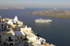Greece, Cyclades, Santorini: dawn breaks over Santorini and a cruise ship lies at anchor - photo by P.Hellander