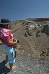 Greece, Cyclades, Santorini: a visitor (LPI photographer Stella Hellander) stares into the caldera inthe centre of Megali Kameni - photo by P.Hellander