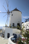 Greece, Cyclades, Santorini:restored windmill in clifftop village of Oia - photo by P.Hellander