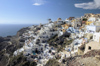 Greece, Cyclades, Santorini:the village of Oia perches atop a clifftop overlooking the Aegean Sea - photo by P.Hellander