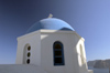 Greece, Cyclades, Santorini:the striking blue cupola of a church in Oia - photo by P.Hellander