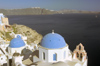 Greece, Cyclades, Santorini:the clifttop village of Oia overlooks the caldera - photo by P.Hellander