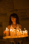 Greece - Paros: young woman lights candles in the Ekatontapyliani Church in Paroikia - photo by D.Smith