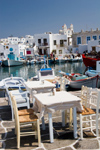 Greece - Paros: restaurant tables of the harbour in Naousa town - photo by D.Smith