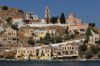 Greek islands - Dodecanese archipelago - Symi island - Symi town - houses and church on the waterfront - photo by A.Dnieprowsky