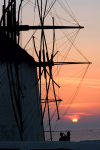 Greek islands - Mykonos (Hora) / Mikonos / JMK - Hora: windmills at sunset with couple - photo by D.Smith