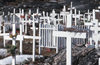 Greenland - Ilulissat / Jakobshavn - cemetery with simple wood crosses, partly decorated with plastic flowers - photo by W.Allgower