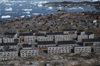 Greenland - Ilulissat / Jakobshavn - blocksof modern flats replaced timber houses - in the background the hospital and Disko bay - photo by W.Allgower