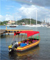 Grenada - St. George's - Carenage harbour - boat with red cover - photo by P.Baldwin