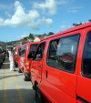 Grenada - public transport abounds - red minibuses (photographer: R. Ziff)