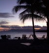 Guadeloupe / Guadalupe / Guadelupe: deck chairs and coconut trees - sunset (photographer: R.Ziff)