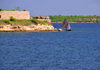 Fort-Libert�, Nord-Est Department, Haiti: a fishing boat sails past Fort Dauphin - photo by M.Torres