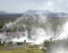 Iceland, Geyser: fumaroles and people fascinated by volcanism - photo by B.Cain