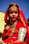 India - Jaisalmer, Rajasthan: a girl with typical clothes and jewels during the camel festival - photo by E.Petitalot
