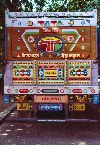 India - New Delhi: New Delhi: decorated rear end of a Tata truck - swastikas and blow horn sign (photo by Francisca Rigaud)