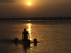 Varanasi, Uttar Pradesh, India: silhouettes bathing in the Ganges river - sunset - photo by J.Hernández