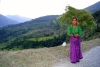 India - Gupt Kashi village (Uttaranchal): young woman gathers grass for stock feed (photo by Rod Eime)