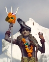 India - Narendranager (Uttaranchal): young man with snake dresses as Lord Shiva - parade marking the beginning of the traditional Hindu October festival of Navaratri (photo by Rod Eime)
