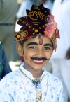 India - Narendranager (Uttaranchal): young boy enjoys taking part in a costume parade - festival of Navaratri (photo by Rod Eime)