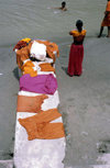 India - Uttaranchal - Rishikesh: clothes of pilgrims bathing in the Ganges - photo by W.Allgöwer