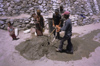India - Ladakh - Jammu and Kashmir: construction workers preparing mortar - photo by W.Allg�wer
