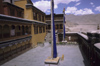 India - Ladakh - Jammu and Kashmir - Tikze: flag poles (Tarcho) in the monastery's inner court - photo by W.Allg�wer