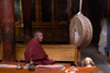 India - Ladakh - Jammu and Kashmir: Tikse gompa - monk and drum - photos of Asia by Ade Summers