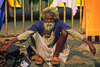 India - Calcutta / Kolkata (West Bengal): a beggar in the front of Howard train station - photo by E.Petitalot