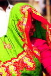 India: colorful clothes of an Indian woman - photo by Eric Petitalot