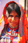 India - Gujarat, India: Harijan girl with covered head and typical jewels and clothes - photo by E.Petitalot