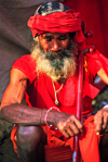 India - Allahabad, Uttar Pradesh: a sadhu begging - photo by E.Petitalot