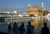 India - Amritsar (Punjab): Golden Temple - evening view of the Sarovar lake and the causeway - photo by E.Andersen