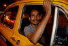 Calcutta / Kolkata, West Bengal, India: taxi driver waiting in Chowringhee - nocturnal - photo by G.Koelman