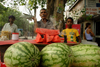 New Delhi, India: watermelon vendor - fruit and burning incense - street life in the Old city - photo by G.Koelman