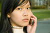 Bali, Indonesia: young Indonesian Asian woman talking on a cellular phone - Model Released - photo by D.Smith