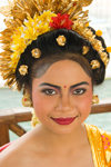 Padangbai, Bali, Indonesia: close-up portrait of young Balinese woman wearing floral hat - photo by D.Smith