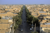 Iran - Yazd: view from a minaret - avenue leading to the Dasht-e Kavir desert - clay brick architecture - photo by W.Allgower