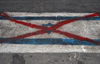 Iran - Shiraz: crossed Israeli flag on the asphalt - Kh. Nobahan street - photo by M.Torres