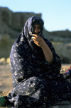 Iran - Fars province: nomadic woman with chador - photo by W.Allgower