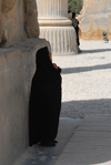 Iran - Persepolis:  Gate of all the nations - an Iranian woman contemplates the work of her Aryan ancestors - wimple - photo by M.Torres