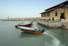 Iran - Hormuz island / Jazireh-ye Hormoz: speedboats to Bandar Abbas and their terminal - photo by M.Torres