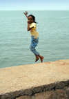 Iran - Hormuz island: a girl jumps into the Persian gulf - photo by M.Torres